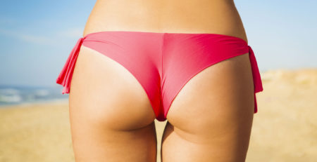 39139191 - butt view of a sexy woman in bikini